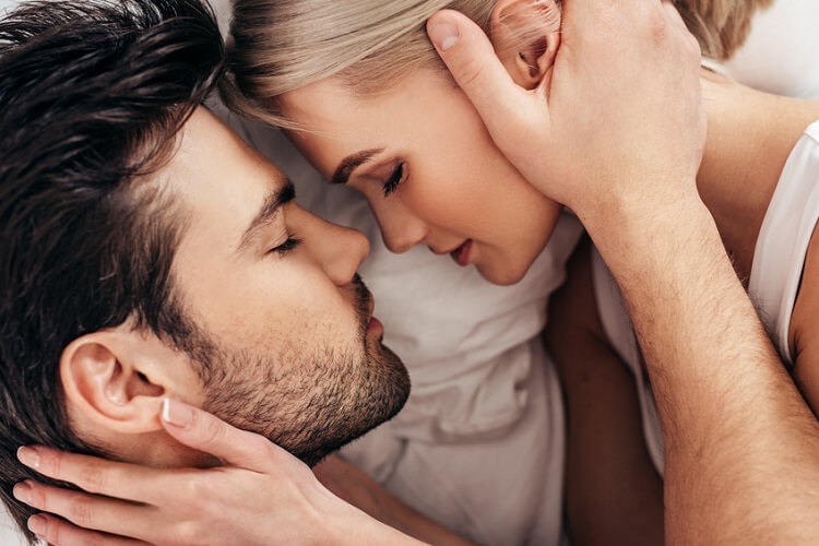 Christian couple is holding each other in romantic way