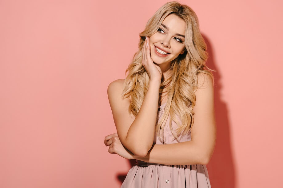 attractive blonde looking undecidedly but smiling