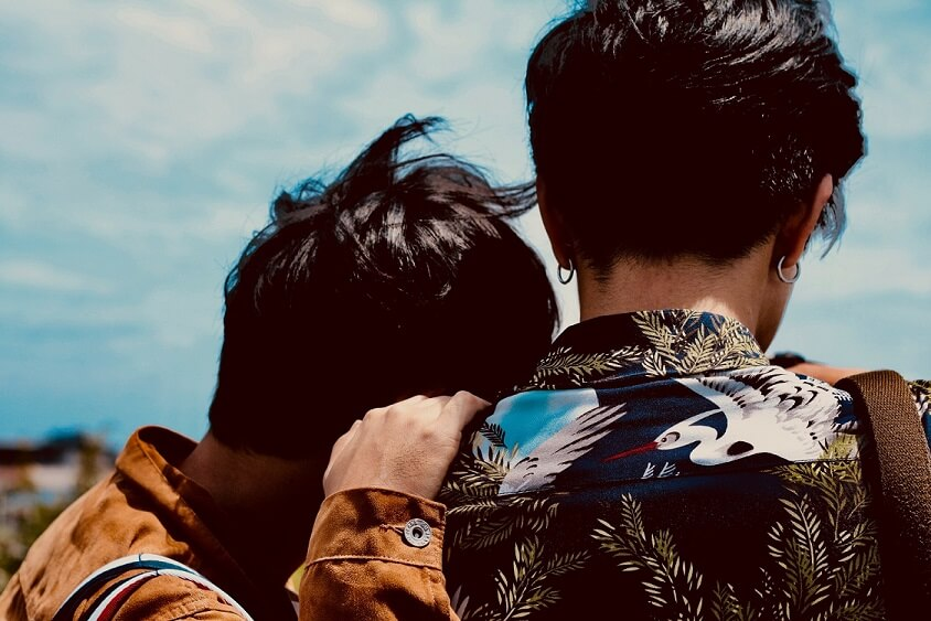 gay couple leaning on each others shoulder