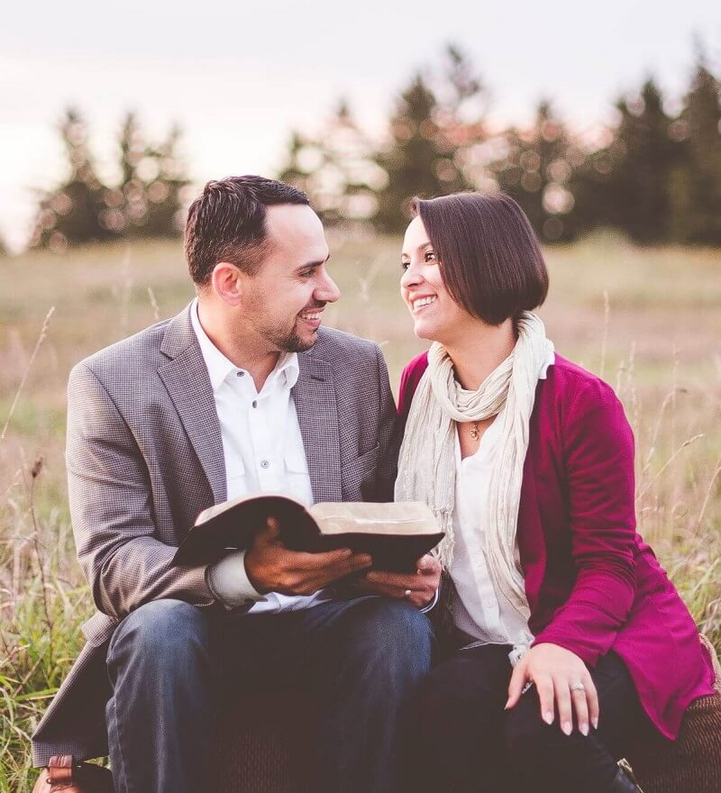 Couple in love reading a Bible together