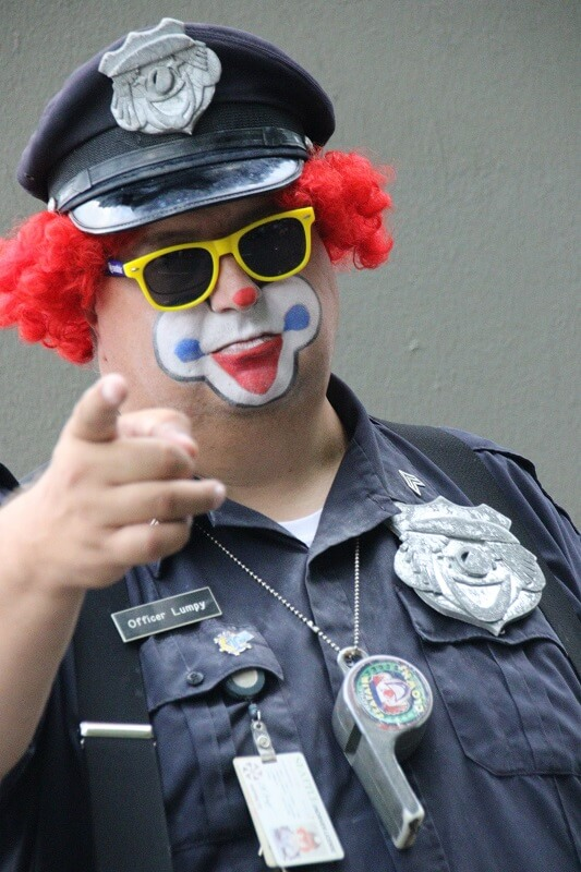 Large clown dressed as a police officer