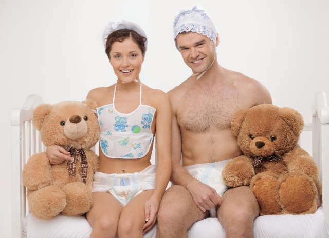 A couple of adults in diapers with teddy bears