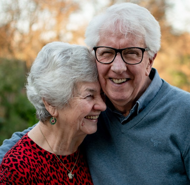 Senior couple laughing as they use dating slang