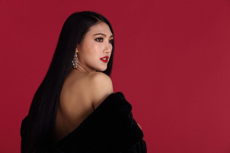 asian transgender woman in elegant coat