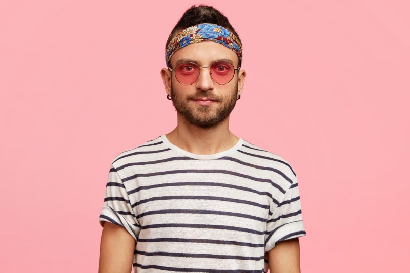 quirky guy with headband and sunglasses