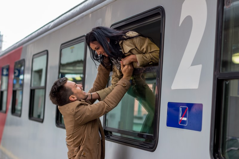 two long distance daters meeting each other while one's on a train